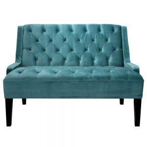 sofa de terciopelo azul con capitone