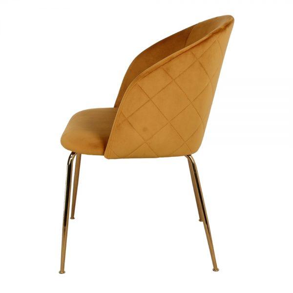 silla tapizada terciopelo ocre y patas doradas